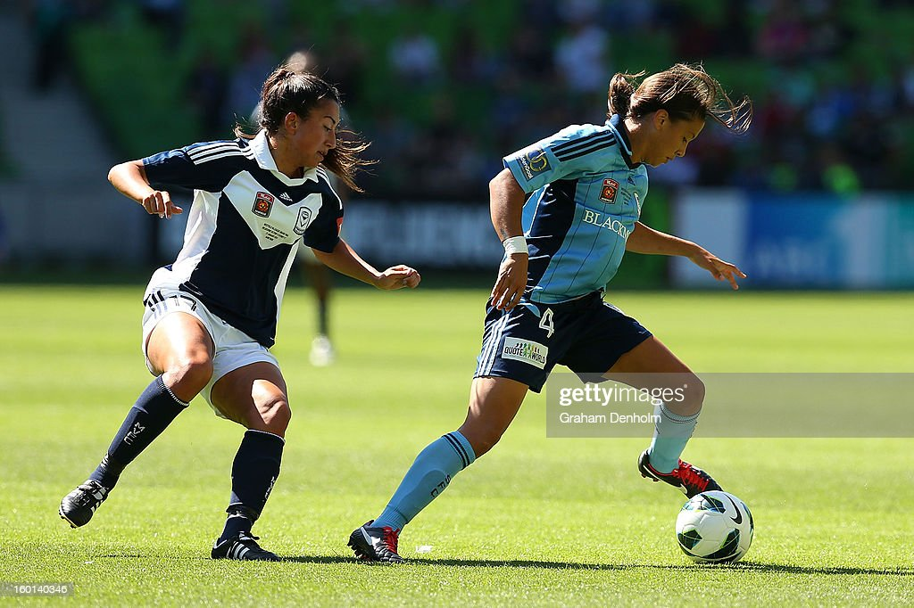 Sammy Kerr of Sydney FC (R) controls the ball under pressure during the W-League Grand Final between the Melbourne Victory and Sydney FC at AAMI Park on January 27, 2013 in Melbourne, Australia.