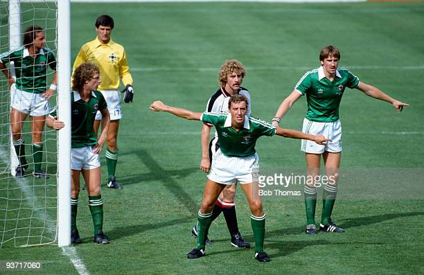 Sammy Nelson of Northern Ireland and the Northern Ireland defence wait for an Austria corner during the Northern Ireland v Austria World Cup Finals...