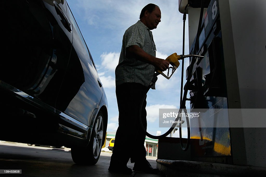Sammy Reiser fills his vehicle up with gas in a county where some grades of gasoline have already surpassed the $4 mark on February 21, 2012 in Miami, Florida. Fears of $5 per gallon gasoline are being heard as summer approaches and some feel that would hurt the economy just as an economic recovery appears to be getting traction.