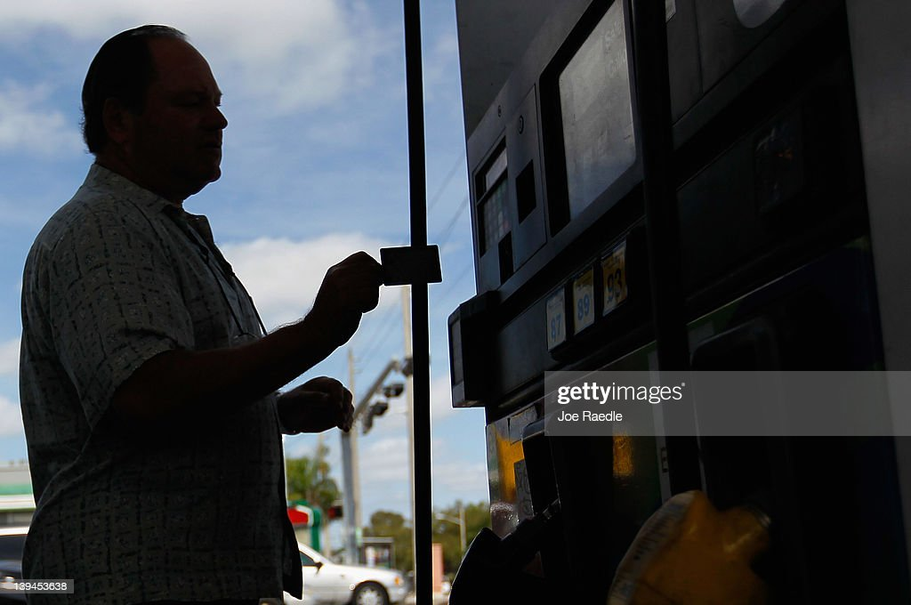 Sammy Reiser uses his credit card to pay at the pump for the gas as he fills his vehicle up with gas in a county where some grades of gasoline have already surpassed the $4 mark on February 21, 2012 in Miami, Florida. Fears of $5 per gallon gasoline are being heard as summer approaches and some feel that would hurt the economy just as an economic recovery appears to be getting traction.