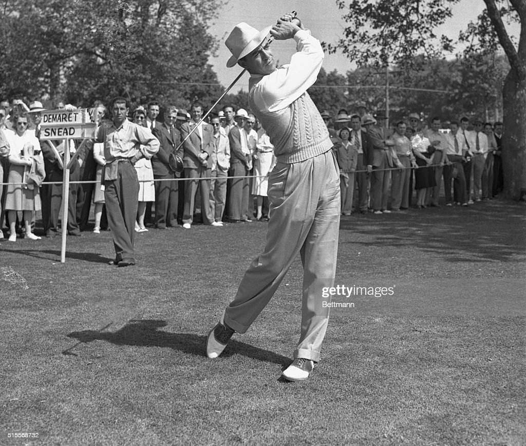 Sammy Snead playing Jim Demaret in the semifinals of the PGA Championship drives off the first tee at the start of the first round of their match...