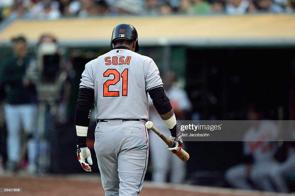 Sammy Sosa #21 of the Baltimore Orioles walks back to the dugout against the Oakland Athletics at McAfee Coliseum on August 16, 2005 in Oakland, California.
