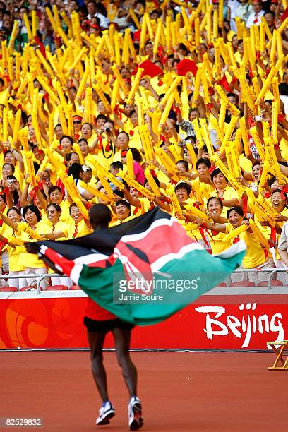 Sammy Wanjiru of Kenya celebrates after winning the Men's Marathon in the National Stadium during Day 16 of the Beijing 2008 Olympic Games on August...