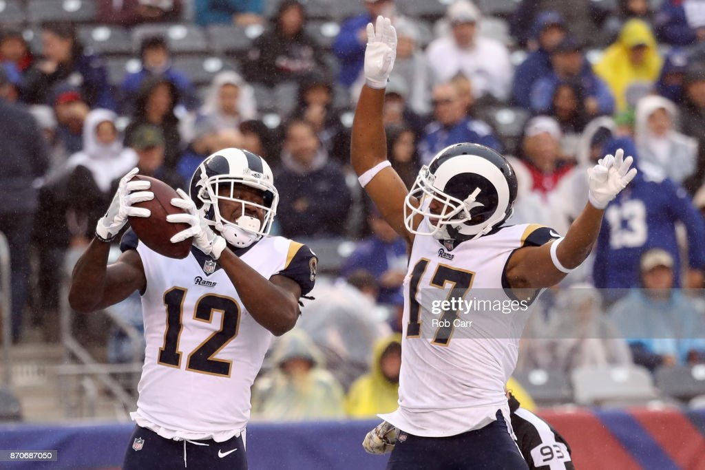 1c73e2852b7 Sammy Watkins 12 celebrates with Robert Woods 17 of the Los Angeles Rams ...