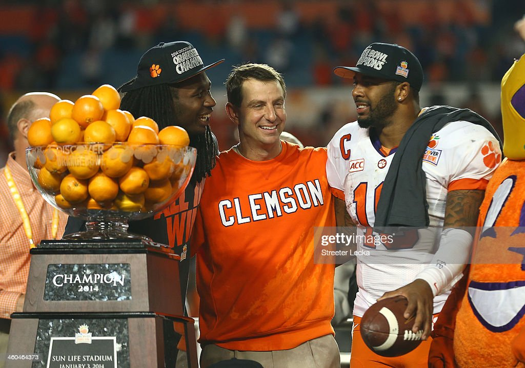 Sammy Watkins #2, head coach Dabo Swinney and Tajh Boyd #10 of the Clemson Tigers celebrate after defeating the Ohio State Buckeyes during the Discover Orange Bowl at Sun Life Stadium on January 3, 2014 in Miami Gardens, Florida. Clemson defeated Ohio State 40-35.