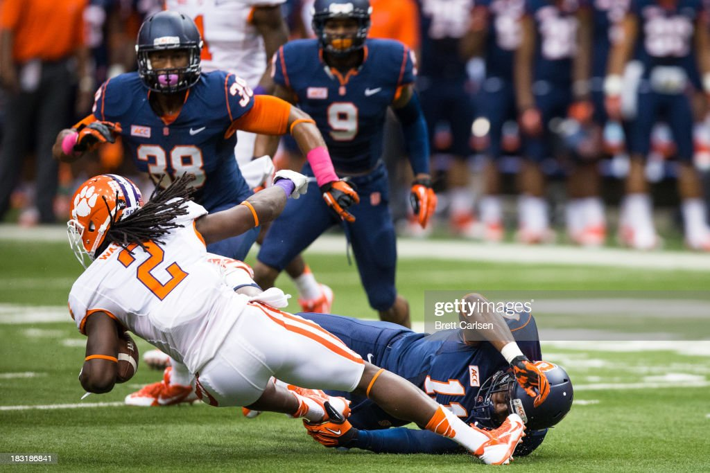 Sammy Watkins #2 of Clemson Tigers is brought down by Marquis Spruill #11 of Syracuse Orange in a first quarter first down reception on October 5, 2013 at the Carrier Dome in Syracuse, New York. Clemson defeated Syracuse 49-14.