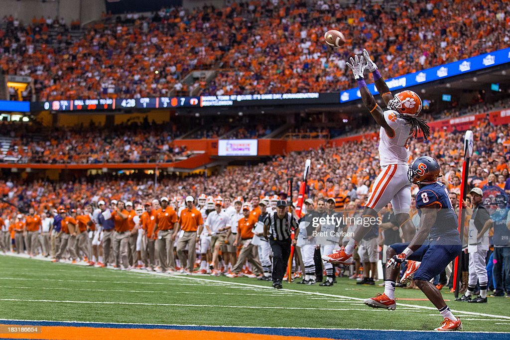 Sammy Watkins #2 of Clemson Tigers jumps for a reception above Keon Lyn #8 of Syracuse Orange resulting in first end goal in the first quarter on October 5, 2013 at the Carrier Dome in Syracuse, New York. Clemson defeated Syracuse 49-14.