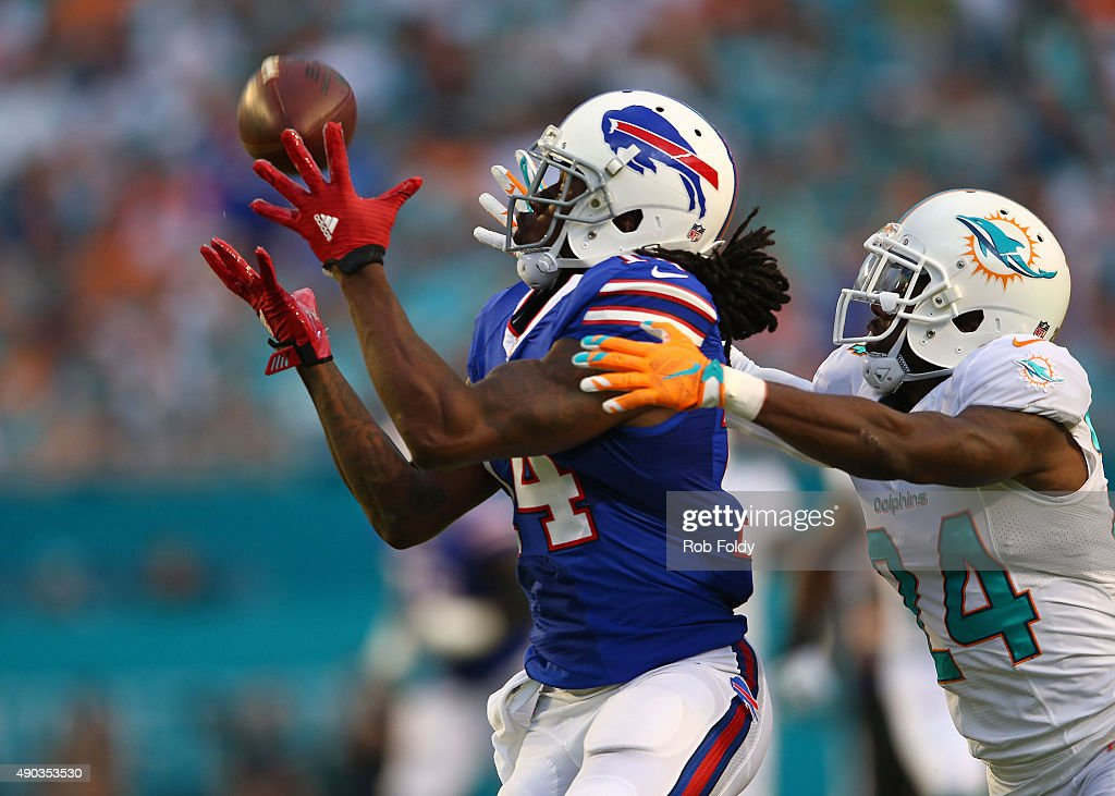 Sammy Watkins #14 of the Buffalo Bills catches a pass past Brice McCain #24 of the Miami Dolphins during the first half of the game at Sun Life Stadium on September 27, 2015 in Miami Gardens, Florida.