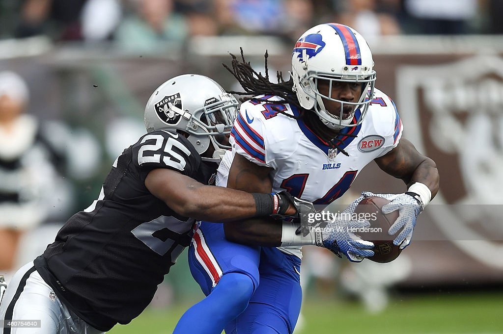 Sammy Watkins of the Buffalo Bills fights the tackle of DJ Hayden of the Oakland Raiders for a touchdown in the first quarter at Oco Coliseum on...