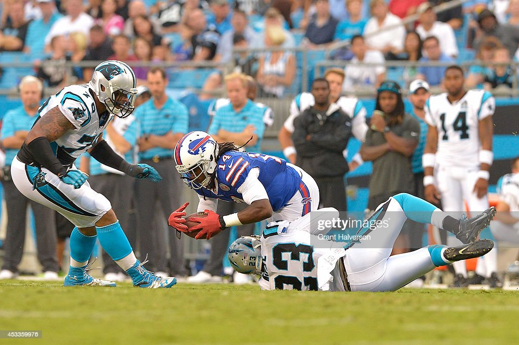 Sammy Watkins #14 of the Buffalo Bills makes a catch between defenders Thomas Davis #58 and Melvin White #23 of the Carolina Panthers during their game at Bank of America Stadium on August 8, 2014 in Charlotte, North Carolina.