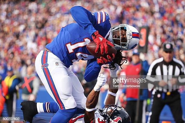 Sammy Watkins of the Buffalo Bills makes a touchdown catch as Kevin Johnson of the Houston Texans defends during the first half at Ralph Wilson...
