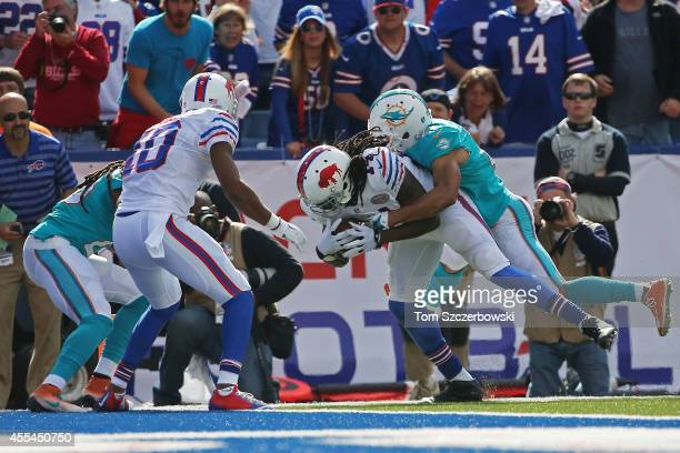 Sammy Watkins of the Buffalo Bills scores a touchdown with Brent Grimes of the Miami Dolphins on his back during the second half at Ralph Wilson...