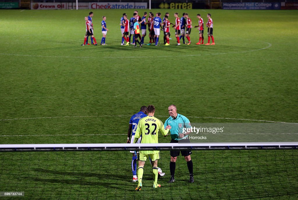 Samni Odelusi of Rochdale scores the winning penalty past Maskymillian Stryjek of Sunderland during the U-23 EFL Checkertrade Trophy Group F match between Rochdale and Sunderland U23 at Spotland Stadium on September 6, 2016 in Rochdale, England.