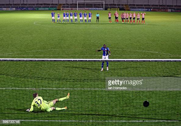 Samni Odelusi of Rochdale scores the winning penalty past Maskymillian Stryjek of Sunderland during the U23 EFL Checkertrade Trophy Group F match...