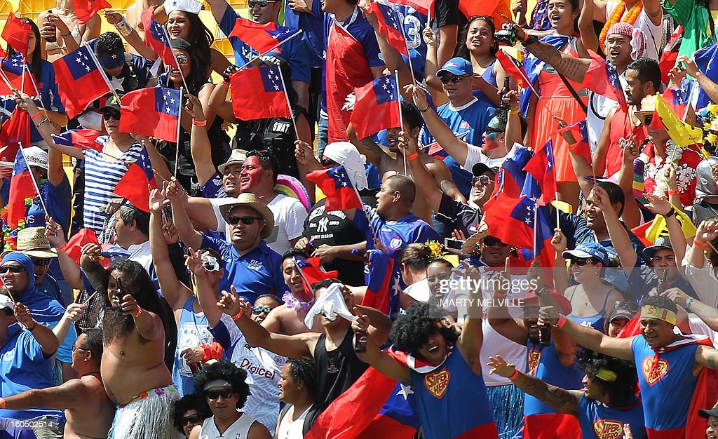 Samoa fans celebrate at the Westpac Stadium on day two of the fourth leg of the IRB Rugby Sevens World Series in Wellington on February 2, 2013. AFP PHOTO / Marty MELVILLE