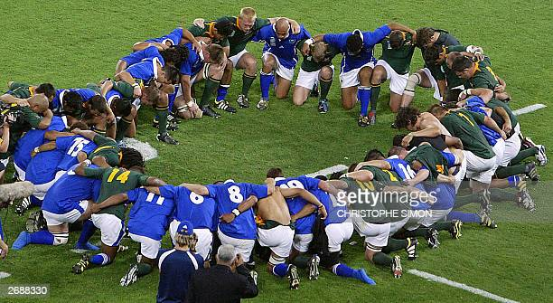 Samoan and South African players congratulate each other at the end of the Rugby World Cup Pool C match between South Africa and Samoa at Lang Park...