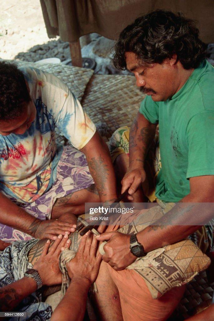 Samoan Man Being Tattooed