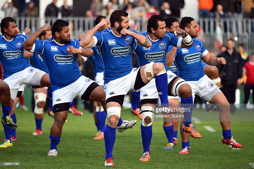 Samoan players perform the Siva Tau their traditional war dance prior the rugby union test match Italy vs Samoa in Ascoli Piceno on November 8 2014...
