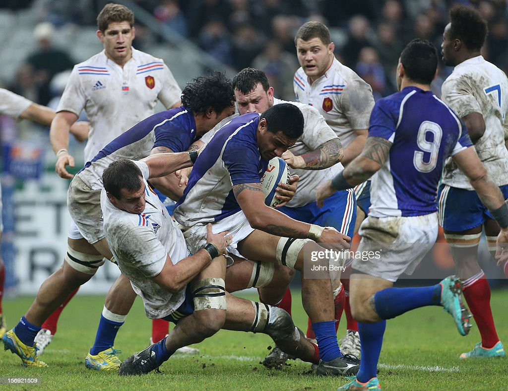 Samoan players trying to keep the ball during the Rugby Autumn International between France and Samoa at the Stade de France on November 24, 2012 in Paris, France.