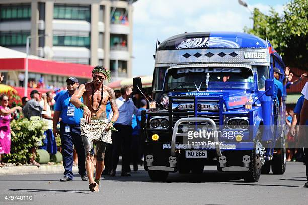 Samoan warrior leads the New Zealand All Blacks in buses during a parade down the main street of Apia on July 7 2015 in Apia Samoa
