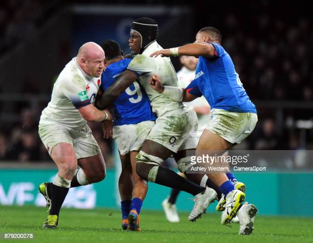 Samoa's Dwayne Polataivao is tackled by England's Dan Cole and Maro Itoje during the 2017 Old Mutual Wealth Series Autumn International match between...