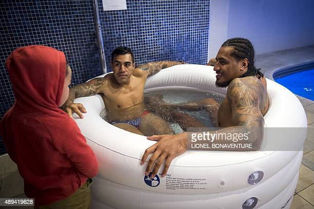 Samoa's fly half Tusi Pisi and Samoa's lock Filo Paulo take an ice bath during a recovering session at the Waterfront Hotel in Brighton on September...