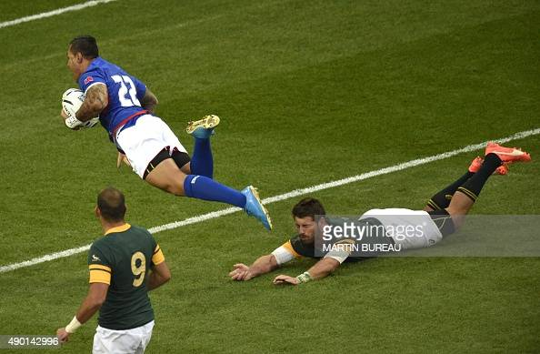 Samoa's fly half Tusi Pisi jumps past South Africa's fullback Willie le Roux to score a try that was later disallowed for a forward pass during the...