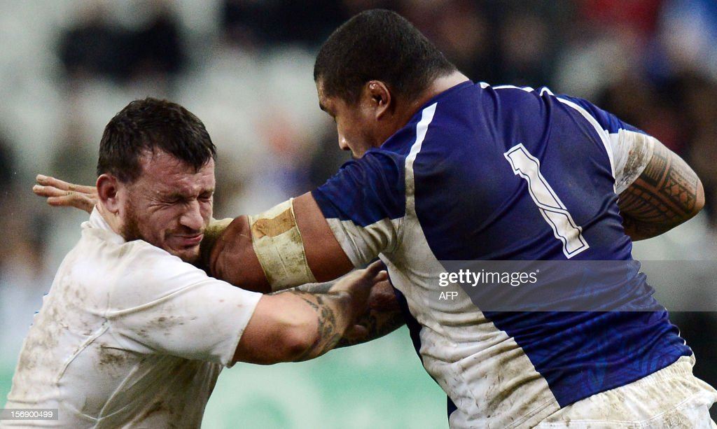 Samoa's loose head prop Sakaria Taulafo (R) vies with France's prop Thomas Domingo during the rugby union test match France vs Samoa at the Stade de France on November 24, 2012 in Saint-Denis, north of Paris. AFP PHOTO / FRANCK FIFE