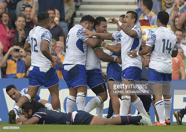 Samoa's number 8 and captain Ofisa Treviranus celebrates with teammates after scoring a try during a Pool B match of the 2015 Rugby World Cup between...