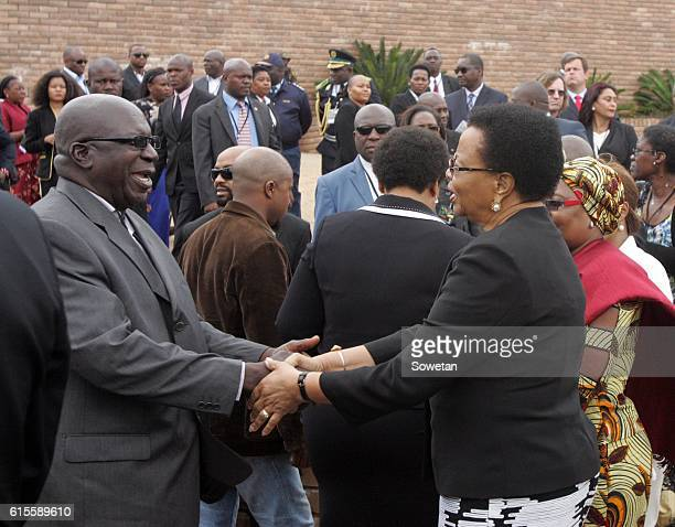 Samora Machels widow Graca shakes hands with one of the plane crash survivors during the 30th commemoration of Samora Machels death on October 17...