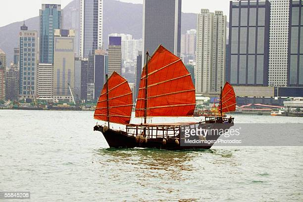 Sampan with red sails at Hong Kong Harbor, Hong Kong, China