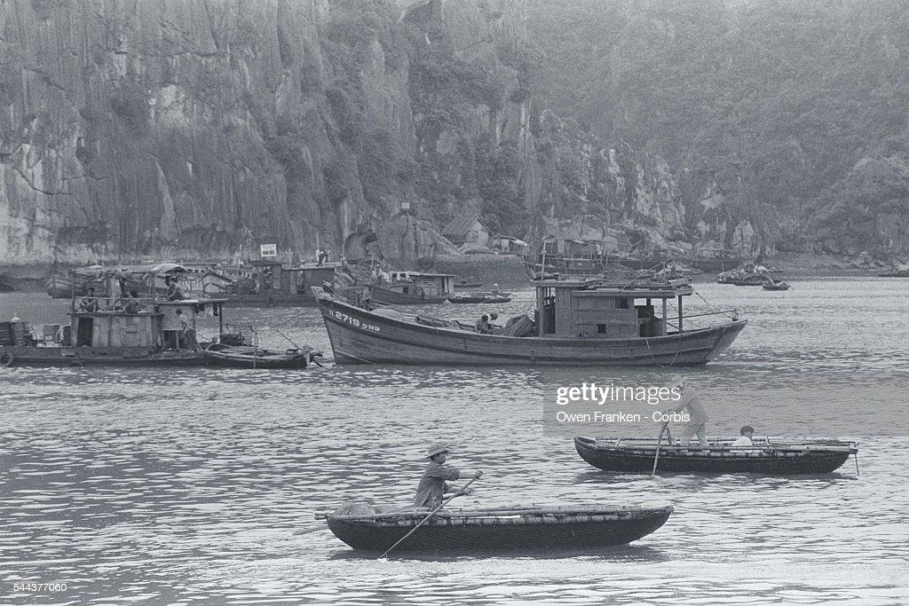 Sampans cross Halong Bay in Quang Ninh Province Vietnam