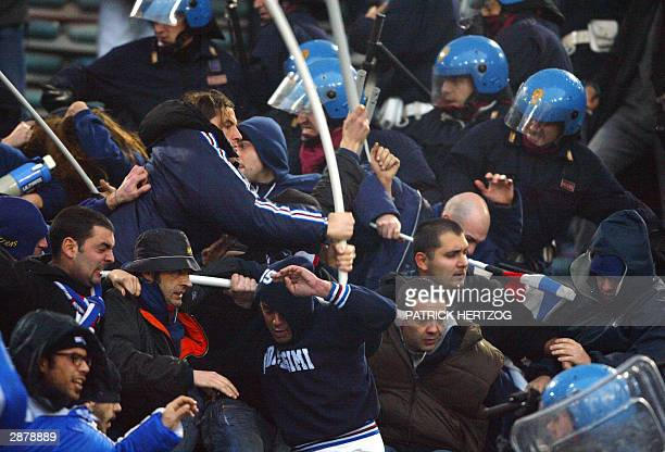 Sampdoria Genoa's fans clash with riot police during their Italian Serie A soccer match between AS Roma and Sampdoria at the Olympic stadium in Rome...