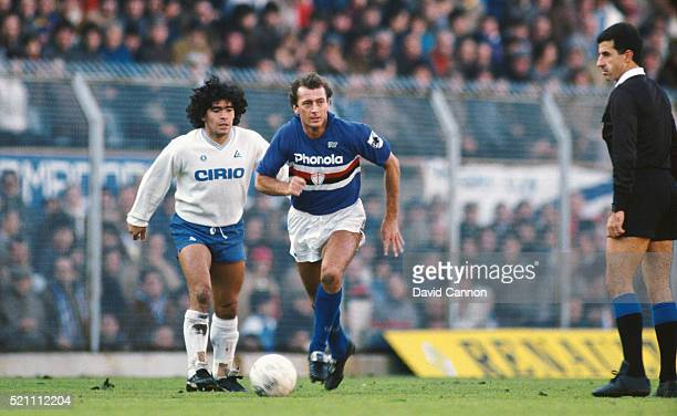 Sampdoria player Trevor Francis in action as Maradona looks on during a Serie A match between Sampdoria and Napoli circa 1984 in Genoa Italy