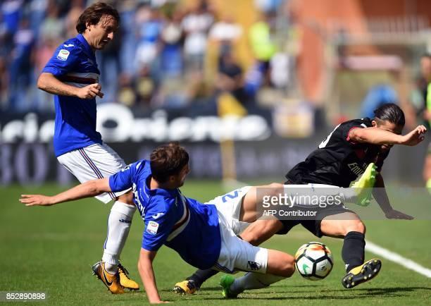 Sampdoria polish defender Bartosz Bereszynski vies with Ac Milan swiss defender Ricardo Rodríguez during the Italian Serie A football match between...