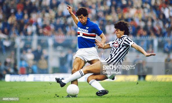 Sampdoria striker Gianluca Vialli rides the challenge of Paolo Pochesci of Ascoli during a match circa 1984 in Genoa Italy