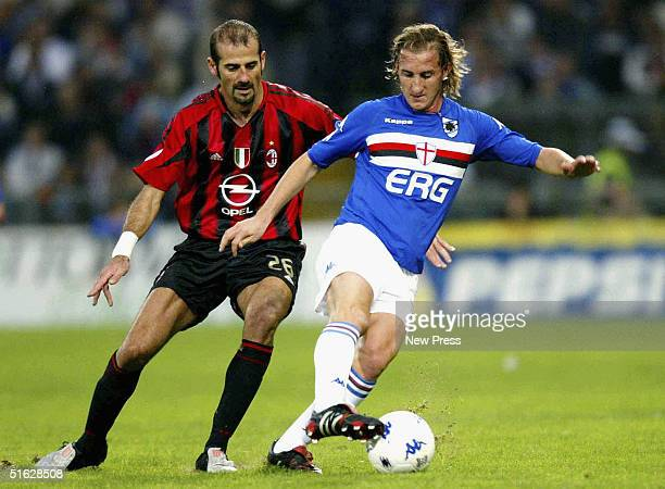 Sampdoria's Aimo Diana avoids the challenge from Milan's Giuseppe Pancaro during the Italian Serie A match between Sampdoria and AC Milan at Stadio...
