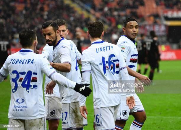 Sampdoria's Colombian forward Luis Fernando Muriel Fruto celebrates with teammates after scoring during the Italian Serie A football match AC Milan...