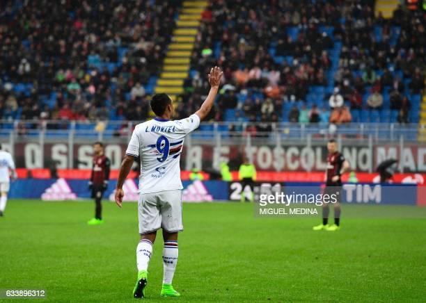 Sampdoria's Colombian forward Luis Fernando Muriel Fruto greets fans after scoring a penalty during the Italian Serie A football match AC Milan vs...