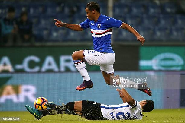 Sampdoria's Colombian forward Luis Fernando Muriel vies for the ball with Inter Milan's Colombian defender Jeison Murillo during the Italian Serie A...