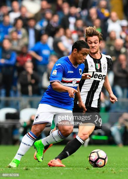 Sampdoria's Colombian forward Luis Fernando Muriel vies with Juventus' Italian defender Daniele Rugani during the Italian Serie A football match...