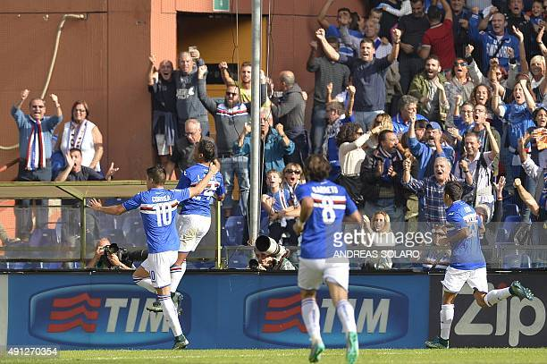 Sampdoria's forward from Colombia Luis Muriel celebrates with fans after scoring during the Italian Serie A football match Sampdoria vs Inter Milan...