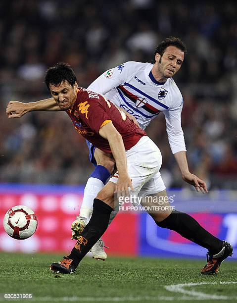 Sampdoria's forward Nicola Pazzini vies with AS Roma's Argentinian defender Nicolas Burdisso during their Serie A football match in Rome's Olympic...
