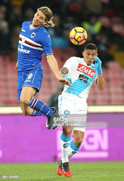 Sampdoria's midfielder from Belgium Dennis Praet fights for the ball with Napoli's midfielder from Brazil Allan during the Italian Serie A football...