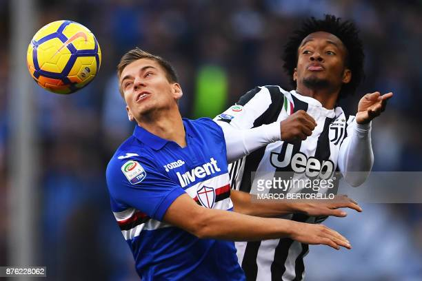 TOPSHOT Sampdoria's midfielder Ivan Strinic from Croatia fights for the ball with Juventus' midfielder Juan Cuadrado from Colombia during the Italian...