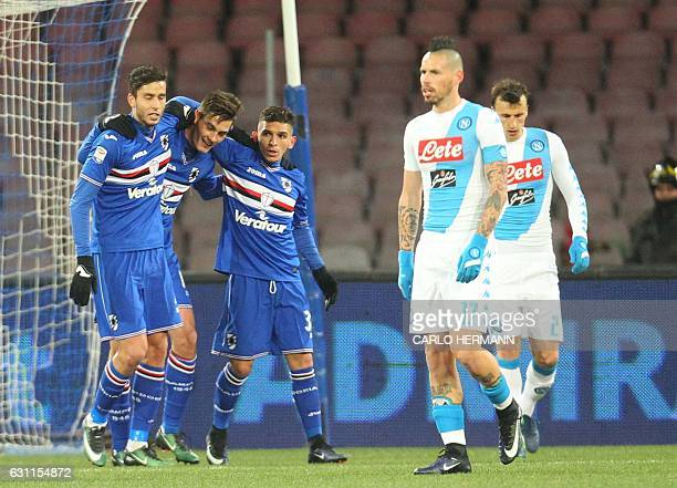 Sampdoria's players celebrate after a Napoli's own goal during the Italian Serie A football match SSC Napoli vs UC Sampdoria on January 7 2017 at the...