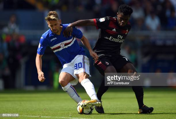 Sampdoria'su Uuguayan midfielder Gaston Ramirez vies with AC Milan's Ivorian midfielder Franck Kessie during the Italian Serie A football match...