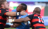 Sampie Mastriet of Blue Bulls tackled by Marcello Sampson of Eastern Province Kings during the Vodacom Cup Quarter Final match between Vodacom Blue...