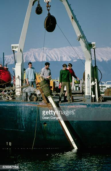 A sample from the bottom of the Black Sea is hoisted on board the research vessel Atlantis II during a survey by the Oceanographic Institute of Woods...