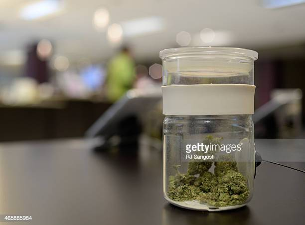 A sample of marijuana is in a jar for customer to look at and smell at Euflora Dispensary in Denver March 11 2015 Colorado pot sales soar to record...